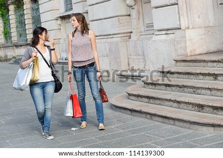 Young Women in the city after Shopping, Italy - stock photo