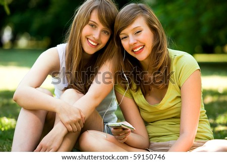 Young women listening to MP3 player