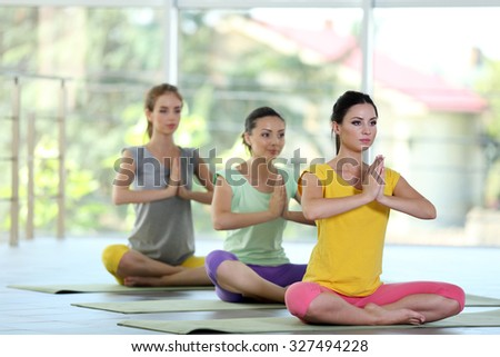 Young women meditating in yoga pose - stock photo