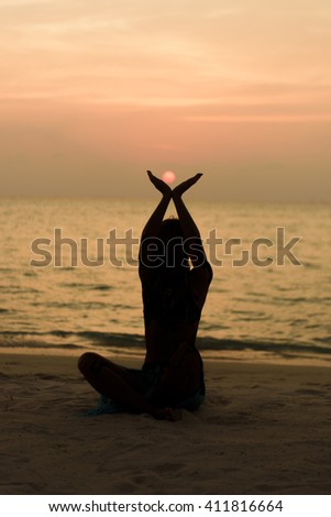 Young women on the beach and enjoy the sunset
