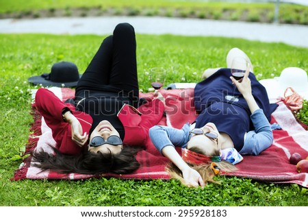 Young women on the red picnic blanket