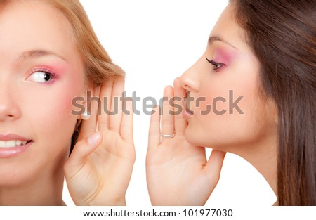 young women or teens whispering secrets scandal or gossip - stock photo