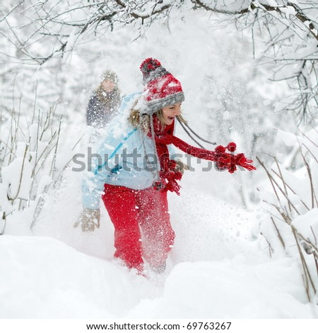 young women outdoor enjoying the snow - stock photo