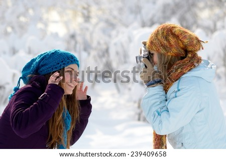 young women outdoor taking photos - stock photo