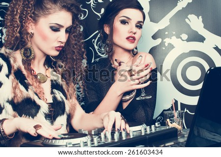 young women partying in a nightclub  - stock photo