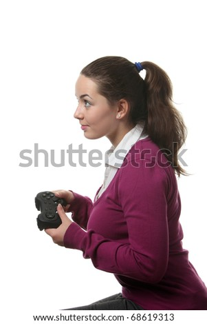 Young women play wideogame by gamepad on the white isolated background - stock photo