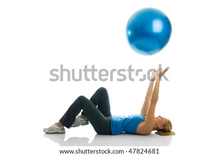 Young women playing with a fitness ball. Isolated on white