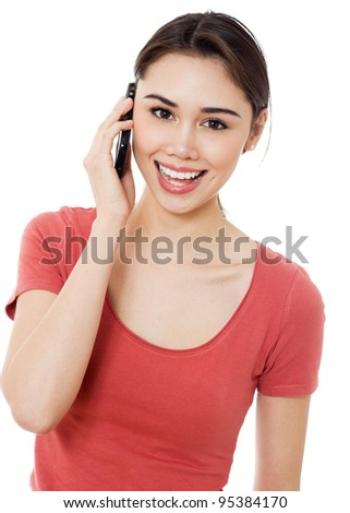 Young women portrait talking via mobile phone against white background