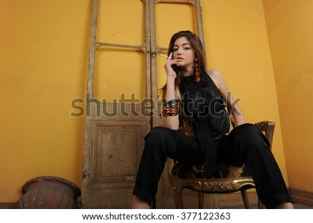 young women posing in old house, girl wearing white shot pant and black shoes