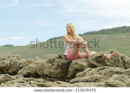 young women posing on the beach - stock photo
