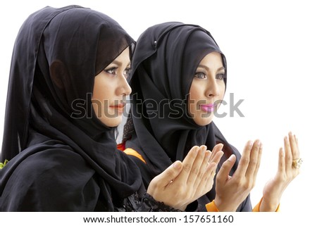 Young Women Praying,isolated on white background - stock photo