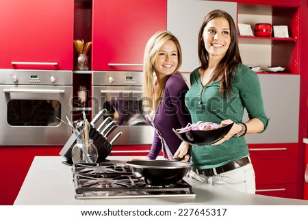 Young women preparing meal in the kitchen