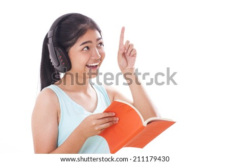 young women reading a book and pointing up.