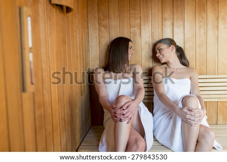 stock photo young women relaxing in sauna 279843530