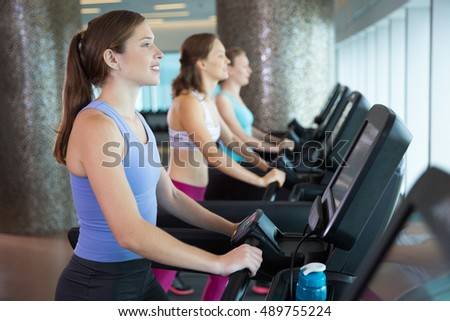 Young Women Running on Treadmills in Fitness Club