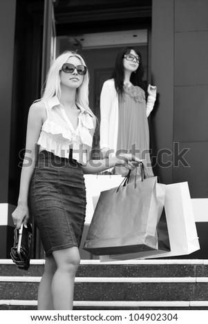 Young women shopping - stock photo