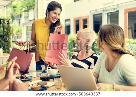 Young Women Shopping Bags Concept