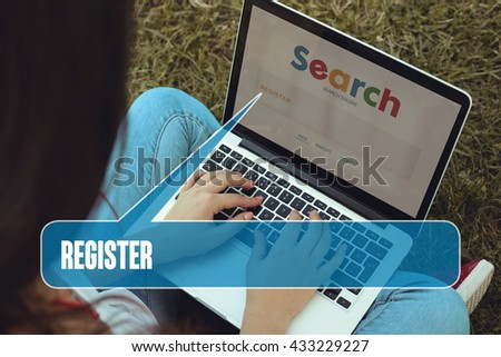 Young women sitting on the grass on a Tablet PC is searching for Register.