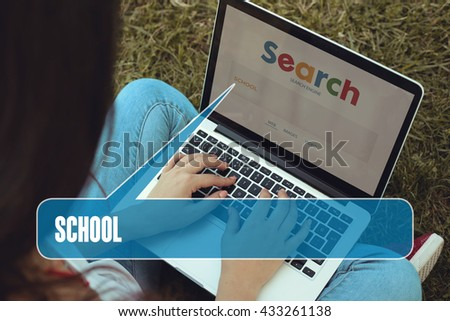 Young women sitting on the grass on a Tablet PC is searching for School.
