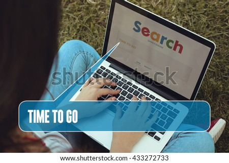 Young women sitting on the grass on a Tablet PC is searching for Time To Go.