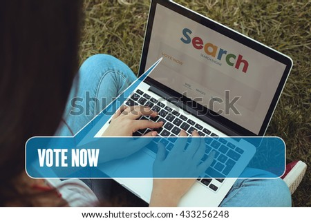 Young women sitting on the grass on a Tablet PC is searching for Vote Now.
