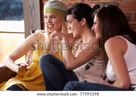 Young women sitting together and talking - stock photo