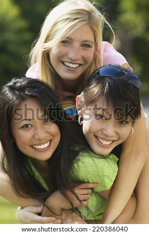 Young women smiling together - stock photo