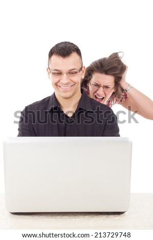 young women spying on men because  infidelity while he chatting over the internet, cyber web infidelity - stock photo