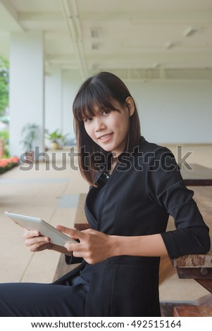 young women thinking about something while sitting front portable laptop computer