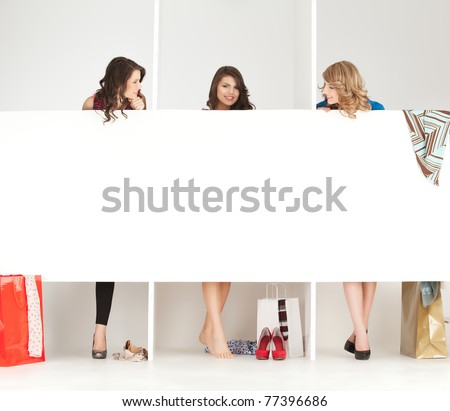 young women trying clothes shop wordrobe - stock photo