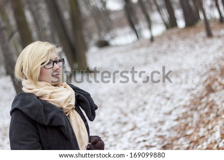 Young women walking in park - winter time. - stock photo