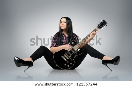 Young women with a electric guitar - stock photo