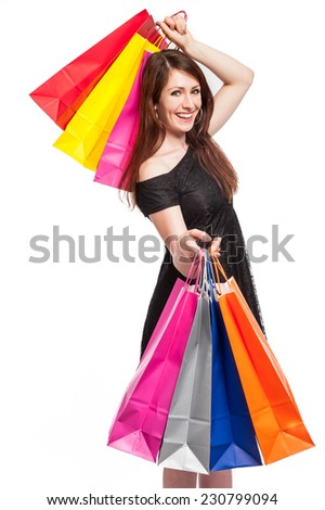 Young women with lots of bright coloured shopping bags. Studio shot with white background. - stock photo