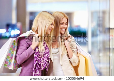 Young women with shopping bags in shop - stock photo