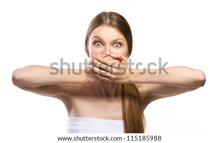 young women with wide-open eyes and closing  mouth with her hands isolated on white - stock photo