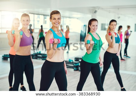 Young women working out using dumbbells
