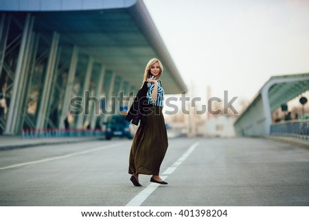 young wonderful   funny  girl going  on a wide street
