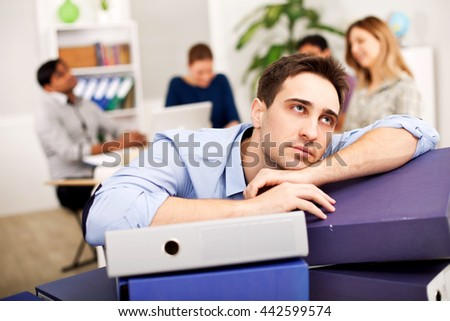 Young worker exhausted from working too much
