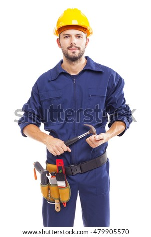 Young worker holding a hammer, isolated on white background