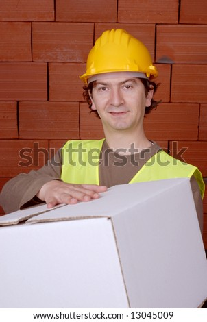 young worker man with helmet, holding box - stock photo