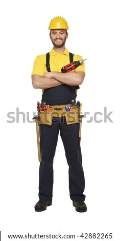 young worker standing with red drill isolated on white background