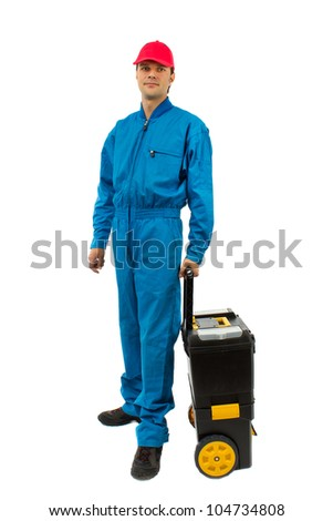 young worker wearing blue equipment tool box with wheels isolated on white - stock photo