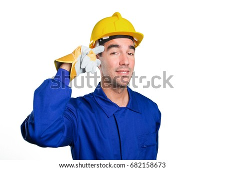 Young worker with a gesture of concentration on white background