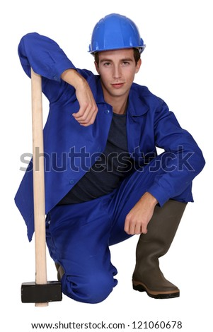 Young worker with a sledgehammer - stock photo