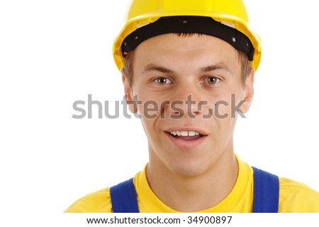 Young worker with perplexed look wearing hard hat and blue-and-yellow uniform, isolated over white - stock photo