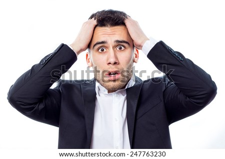 Young worried businessman with hands on his head - stock photo