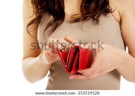 Young worried woman with an empty wallet. - stock photo