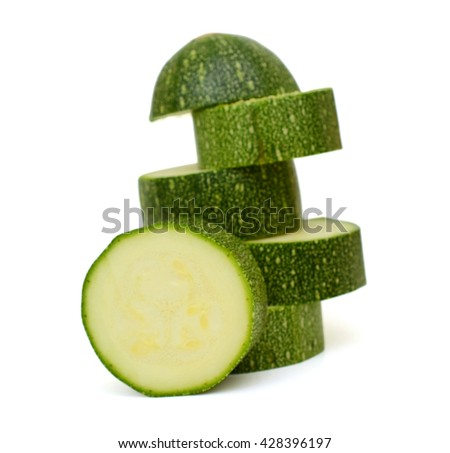 Young zucchini with slice isolated on white background