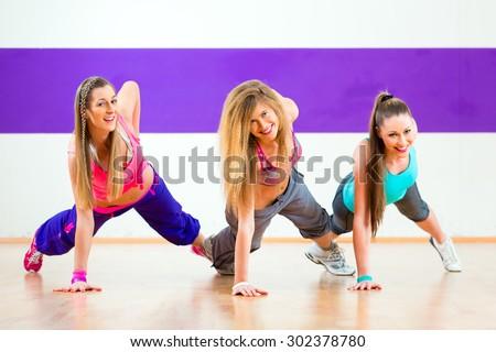 Young zumba women dancing modern group choreography in dance school - stock photo
