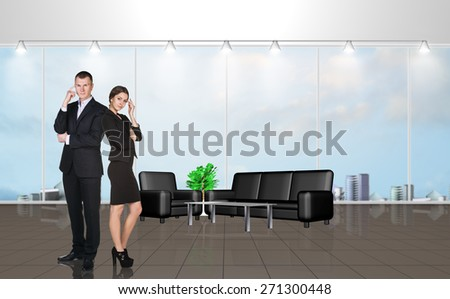 Younge people in the modern office with large windows - stock photo